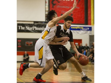 Archbishop O'Leary Spartans' Tristen Kamal moves the ball against the Garden City Collegiate Fighting Gophers at the annual BRIT basketball classic, January 9, 2016.