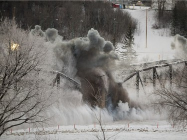 The first two sections of the Traffic Bridge are demolished with explosives on  January 10, 2016.