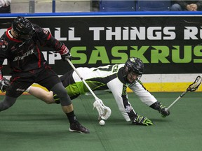 Saskatchewan Rush #17 Robert Church is knocked down by a Stealth player chasing the ball against the Vancouver Stealth in the Rush's first game at SaskTel Centre bringing national league lacrosse to Saskatoon, January 15, 2016.