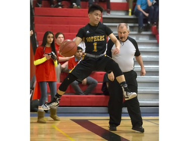 Christian De Leon of the Garden City Fighting Gophers saves the ball from going out of bounds during opening game action in the annual BRIT basketball classic, January 7, 2016.