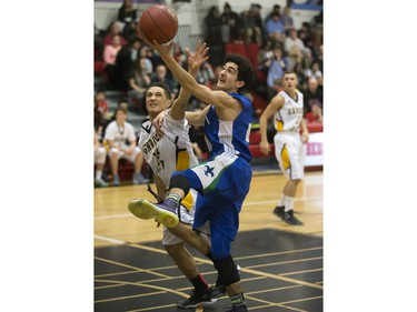 Taijal Verma of the Bishop James Mahoney Saints, blue, goes for the rebound with Marcel Arruda-Welch of the Garden City Fighting Gophers during the annual BRIT basketball classic  Friday, January 08, 2016.