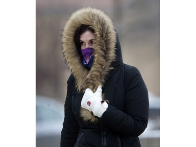 Pedestrians in Saskatoon were bundled up for the extreme wind chill and snow in the city,  Monday, January 18, 2016.