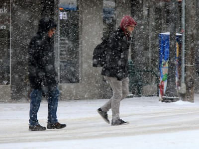 Pedestrians in Saskatoon were bundled up for the extreme windchill and snow in the city, January 18, 2016.
