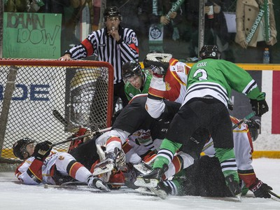 University of Saskatchewan Huskies and University of Calgary Dinos swarm the Dinos' net in CIS Men's Hockey playoff action at Rutherford rink on the U of S campus, February 27, 2016.