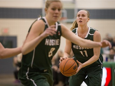 University of Saskatchewan Huskies guard Laura Dally moves the ball against the University of Alberta Pandas in CIS Women's Basketball action, Feb. 13, 2016.