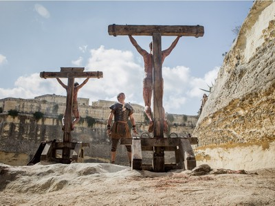 """Jesus crucified along with other convicted criminals in Columbia Pictures' """"Risen."""""""