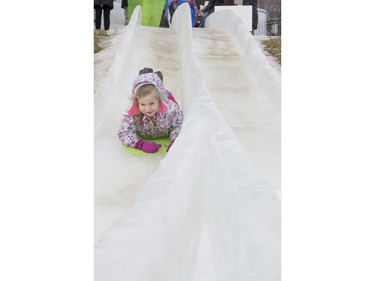 Four-year-old Keylie Lapointe slides down an ice slide at Frosted Gardens on the Bessborough Hotel grounds, February 6, 2016.