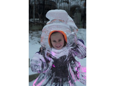 Kennedy Voss poses inside an ice sculpture during the Frosted Gardens ice park and sculpture display at the Bessborough Hotel, February 1, 2016.