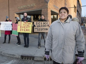 Sheila Tataquason, right, with supporters outside the provincial courthouse on Thursday, Feb. 25, 2016, is suing Saskatoon police for damages she suffered when she was attacked by a police dog and arrested for a crime she didn't commit.