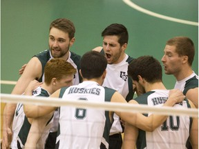 The University of Saskatchewan Huskies celebrate a point against the University of Regina Cougars in CIS men's volleyball action on Saturday, Feb. 20, 2016.