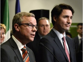 Saskatchewan Premier Brad Wall (left) and Prime Minister Justin Trudeau at a First Ministers meeting at the Canadian Museum of Nature in Ottawa on Nov. 23, 2015.
