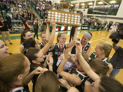 The University of Saskatchewan Huskies women's basketball team cheers as they defeat the University of Regina Cougars in the Canada West final in CIS action, March 12, 2016.