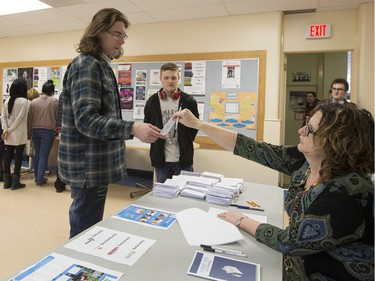Teacher Lori Flath explained the voting process for Nutana High School students who then cast their ballots during voting day for high school students across the province with the upcoming provincial election, March 23, 2016.