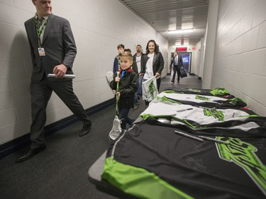 Nine-year-old Cohyn Wells enters SaskTel Centre prior to signing a one-day contract with the Saskatchewan Rush, March 26, 2016. Wells is the Saskatchewan representative for the Children's Miracle Network's Champion Program.