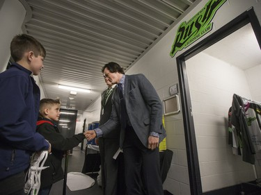 Saskatchewan Rush captain Chris nine-year-old Cohyn Wells prior to signing a one-day contract with the Saskatchewan Rush, March 26, 2016. Wells is the Saskatchewan representative for the Children's Miracle Network's Champion Program.