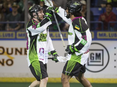 Saskatchewan Rush defence Ryan Dilksin (L) and defence Jeff Cornwall celebrate a goal against the Toronto Rock in NLL action, March 26, 2016.