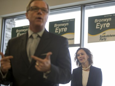 Bronwyn Eyre, Saskatchewan Party candidate Saskatoon Stonebridge-Dakota, looks on as Saskatchewan Premier Brad Wall speaks to campaign volunteers at the Saskatoon Stonebridge-Dakota Campaign Office on March 7, 2016. The Saskatoon Public School Division said it won't be holding a byelection, with discussions about who will be covering Eyre's duties in the lead up to the municipal election, set for Oct. 26.