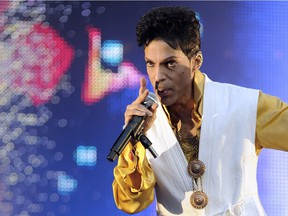 (FILES) This file photo taken on June 30, 2011 shows US singer and musician Prince performing on stage at the Stade de France in Saint-Denis, outside Paris.   Pop icon Prince -- one of the most influential but elusive figures in music -- has died at his compound in Minnesota, entertainment website TMZ reported on April 21, 2016, citing unnamed sources. Local authorities said a death investigation was underway at Prince's Paisley Park complex, but did not give the identity of the fatality.  /