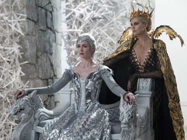 """Emily Blunt (L) and Charlize Theron star in """"The Huntsman: Winter's War."""""""