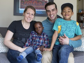 Andrea and Kyle Halstead with their 6-year-old son Noah, and their new adopted son, Seth, who arrived last Sunday from Congo after a long wait.