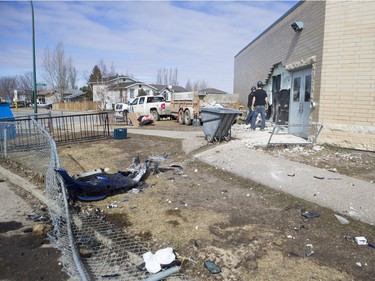 The Saskatoon Police Collision Analyst Unit and workers on the scene of Silverspring School on April 3, 2016. Earlier in the morning a 25-year-old driver went over an embankment and collided with the school.