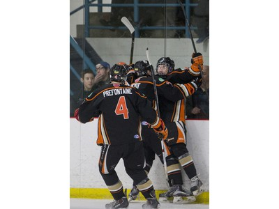 The Saskatoon Contacts and their fans celebrate a goal against the Winnipeg Wild in the first period during the Telus Cup West regional tournament final at Rod Hamm Memorial Arena on Sunday, April 3rd, 2016