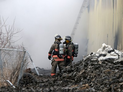 Firefighters continue to battle a fire at Shercom Industries in the North Corman Industrial Park north of Saskatoon, April 5, 2016. The fire has been burning all night and the fuel of recycled rubber products has been hard to extinguish.