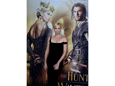 """Actor Charlize Theron arrives for the premiere of """"The Huntsman: Winter's War"""" at the Regency Village Theatre in Westwood, California on April 11, 2016."""