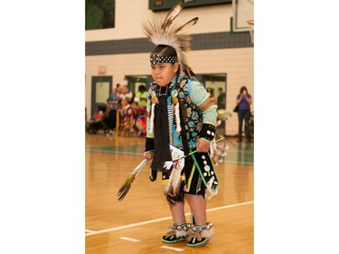 A young dancer takes part in festivities at the University of Saskatchewan Graduation Powwow on May 25, 2016.