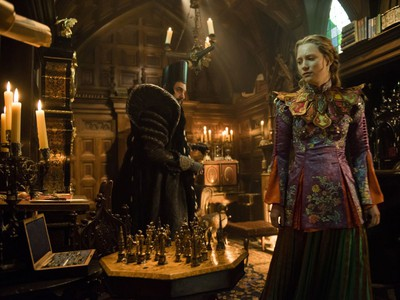 """In this image released by Disney, Sacha Baron Cohen, left, and Mia Wasikowska appear in a scene from """"Alice Through The Looking Glass."""" (Peter Mountain/Disney via AP) ORG XMIT: NYET122"""