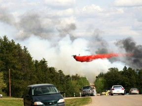 An aircraft drops fire retardant on a forest fire just north of Prince Albert in 2010. (Prince Albert Daily Herald)