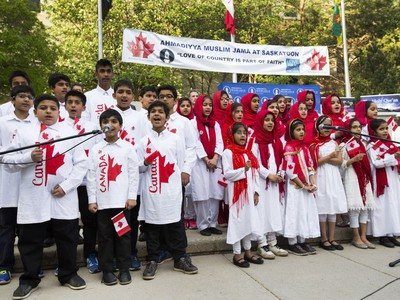 Children sing O' Canada at the Ahmadiyya Muslim Jama`at Canada celebration of 50 years of successfully integrating into Canada in Civic Square in Saskatoon, May 18, 2016. National President of the Ahmadiyya Muslim Jama`at, Mr. Lal Khan Malik, received a proclamation from Mayor Don Atchison proclaiming Ahmadiyya Muslim Day at the ceremony.