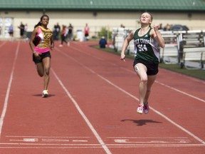 Lauren Weisgerber finished first in her 100-metre sprint heat a few strides ahead of her competitors at the Saskatoon High School Track and Field Championships at Griffiths Stadium, May 26, 2016.