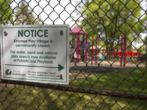 A city of Saskatoon sign warns park goers that the old Kinsmen play village is now closed in Saskatoon, Saskatchewan on Friday, May 20th, 2016.