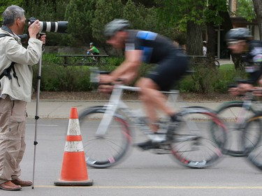 Cyclists speed by a photographer during the category 1 and 2 race at Bikes on Broadway in downtown Saskatoon on May 22, 2016.