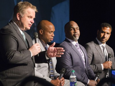 L-R: Sports dignitaries, including CFL on TSN host Rod Smith, Kerry Joseph,  FL on TSN analyst Duane Ford and CFL on TSN analyst Jock Climie on stage during the annual Huskies Dog's Breakfast event at Prairieland Park, May 5, 2016.