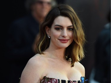 """Acor Anne Hathaway attends the premiere of Disney's """"Alice Through The Looking Glass,"""" May 23, 2016 at the El Capitan Theatre in Hollywood, California."""