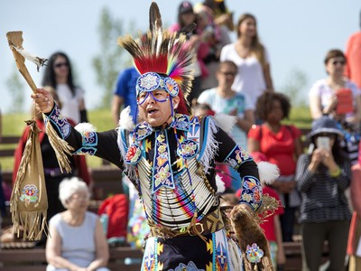 Indigenous dancers in the grand entry at the amphitheatre at Wanuskewin Heritage Park at the opening of the Aboriginal Day Celebration, June 21, 2016.