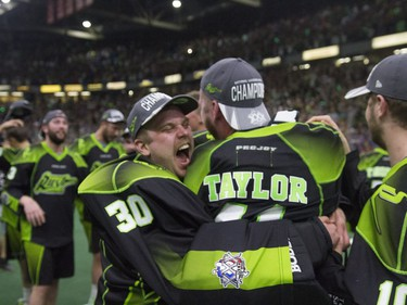 The Saskatchewan Rush celebrate after an 11-10 victory over the Buffalo Bandits during the NLL Championship game at SaskTel Centre in Saskatoon, June 4, 2016.