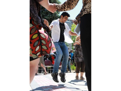 Abdullah Seif Aldeen celebrates World Refugee Day put on by the Saskatoon Refugee Coalition at Civic Square at City Hall in Saskatoon on June 20, 2016.