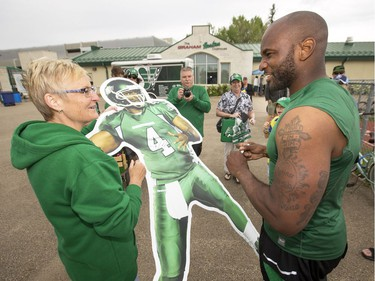 Donna Stewart from Grande Prairie, AB gets an autograph from the real Darian Durant, quarterback, during Rider training camp at Griffiths Stadium in Saskatoon, Friday, June 03, 2016.
