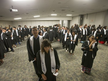 About 200 grads took part in convocation ceremonies for the Saskatchewan Indian Institute of Technologies at Prairieland Park, June 16, 2016. Backstage the grads had their photos taken and were instructed in the procession.