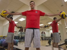 """Team Canada volleyball player and 2016 Olympian Gavin Schmitt poses for a photo at the PAC. At 6'10"""", Schmitt fills the doorway and has an impressive wing span. (GREG PENDER/STAR PHOENIX)"""