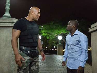 """Dwayne Johnson (L) and Kevin Hart star in """"Central Intelligence."""""""