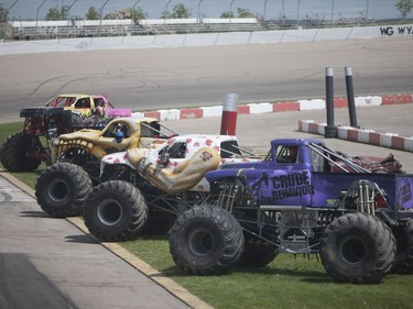 Monster trucks are lined up before the main event at the Monster and Mayhem show at the Wyant Group Raceway in Saskatoon, Saskatchewan on Saturday, July 16th, 2016.