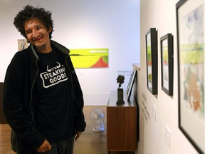 Donald Bird with his paintings and drawings hanging in the Art Placement gallery in Saskatoon on July 26, 2016. (Michelle Berg / The StarPhoenix)
