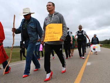 Band councillor Ben Ahenakew and Brett Bird took part in the annual walk for Missing and Murdered Indigenous Women at Ahtahkakoop Cree Nation on August 23, 2016.
