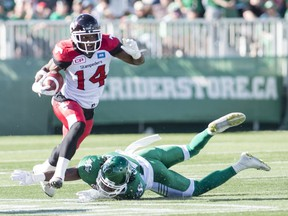 The Calgary Stampeders' Roy Finch, 14, avoids a tackle from the Saskatchewan Roughriders' Major Culbert during Saturday's CFL game at Mosaic Stadium.