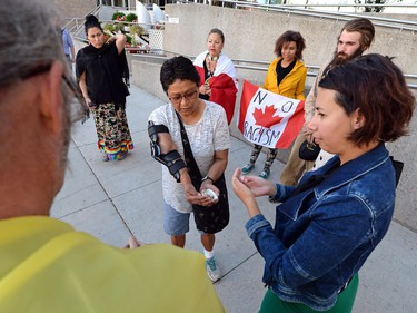 A small group of people gather outside the Provincial Court of Saskatchewan in Regina for a Justice for Colten rally on August 1, 2016. Colten Boushie, a 22-year-old man, was killed near Biggar. Gerald Stanley makes a court appearance in North Battleford charged with second-degree murder in the case.