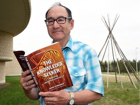 Blair Stonechild with his new book, Knowledge Seeker.